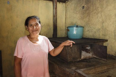 a woman and her cook stove