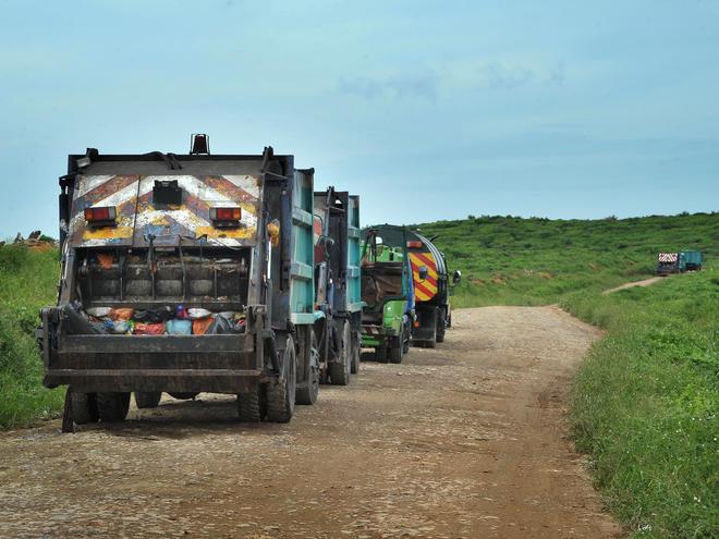 garbage trucks headed to landfill