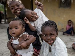 women and children sitting together in Mozambique
