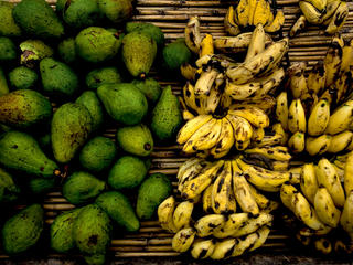 Avocados and bananas for sale