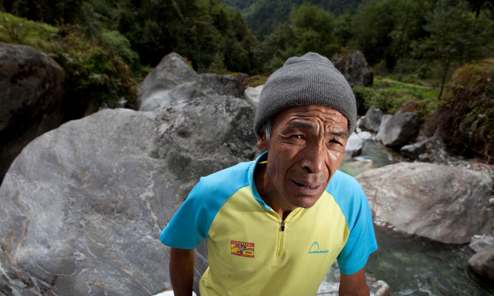 Pasang Themba Sherpa in front of water