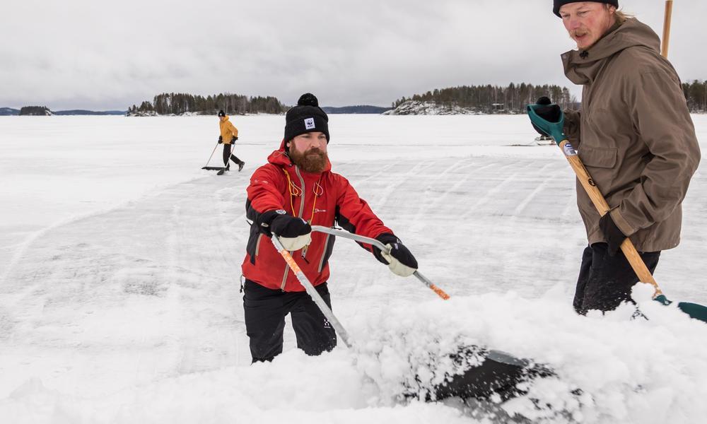 Volunteers making snow banks