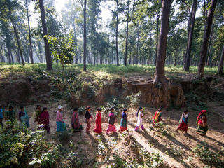 women walk in Nepal forest