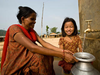 woman and girl gather water in Nepal