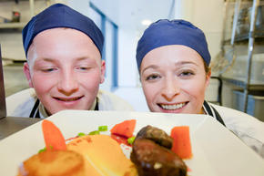 Catering students with a dish they prepared.