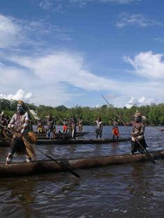 Warriors in canoes