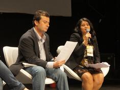 Dekila and man at panel