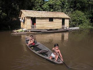 children in canoe in Amazon