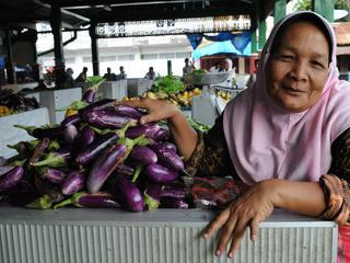 woman selling eggplant