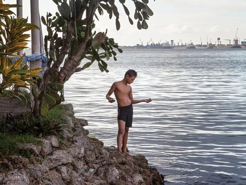 Boy on the shore in Honduras