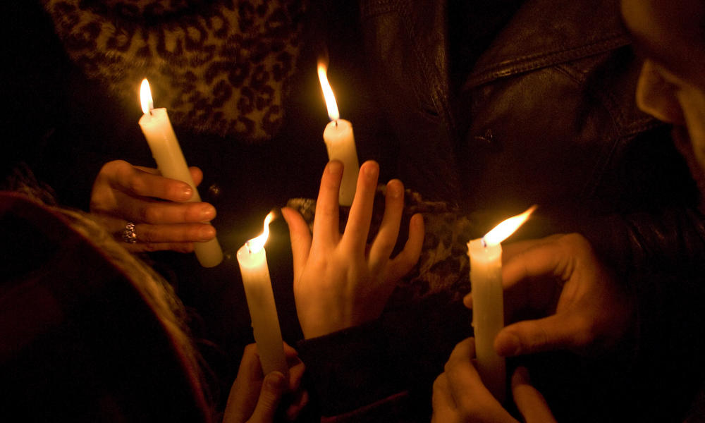 hands holding candles