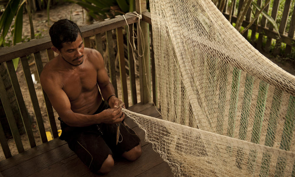 man making fishing net Amazon