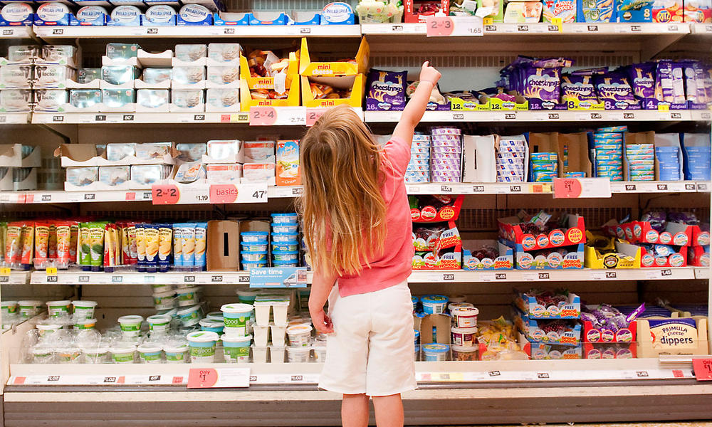 child in grocery store