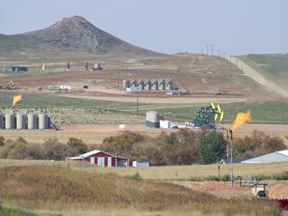 Environmental degradation of the Northern Great Plains from oil extraction.