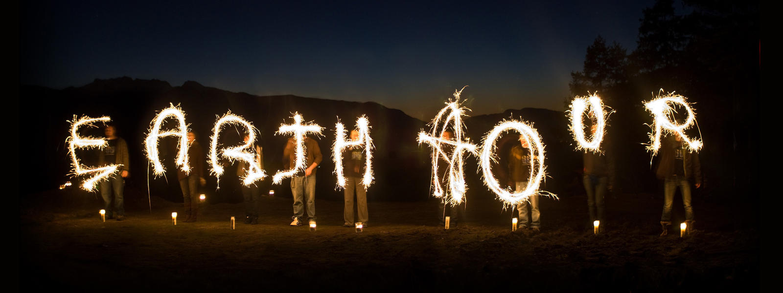 "Earth Hour participants spell out ""Earth Hour"" with sparklers"